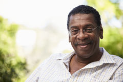 Outdoor Head And Shoulders Portrait Of Senior Man Stock Image