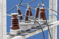 Outdoor High Voltage Instrument Transformers isolated on blue ba Royalty Free Stock Images