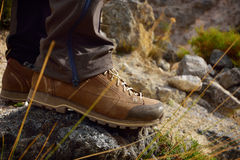 Outdoor hiking shoes in mountains. Royalty Free Stock Images