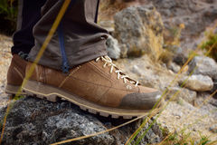 Outdoor hiking shoes on rock trail. Stock Photography