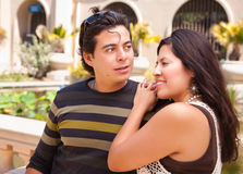 Outdoor Hispanic Couple At The Park. Attractive Hispanic Couple Enjoying Themselves At The Park Stock Images