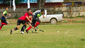 Outdoor Hockey. Hockey player in action during the Thailand National Games royalty free stock photo