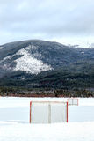 Outdoor Hockey Rink. Hockey nets set up on a lake in the mountains Stock Photography