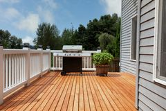 Free Outdoor Home Deck With Bbq Cooker And Herbs Stock Photos - 167790883