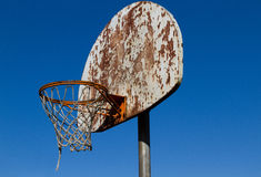 Outdoor Hoops. Outdoor rusted basketball hoop and net Royalty Free Stock Images
