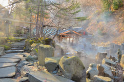 Outdoor hot spring, Onsen in japan in Autumn. Outdoor hot spring with stone walking path, Onsen in japan in Autumn Royalty Free Stock Photography