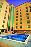 Outdoor Hotel Pool. A bright blue pool outside a hotel in Bahrain Royalty Free Stock Photography