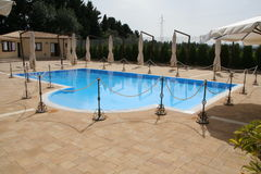 Outdoor hotel swimming pool. Outdoor swimming pool of a hotel Stock Photos