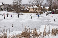 Outdoor ice hokey, players and frozen pond. Travel photo 2018 stock images