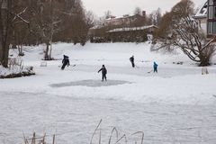 Outdoor ice hokey, players and frozen pond. Travel photo 2018 royalty free stock photography
