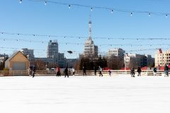 Outdoor ice rink at central square. people slide and have fun. Kharkiv city royalty free stock photo