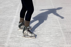 Outdoor Ice Skater and Shadow Royalty Free Stock Images