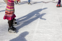 Outdoor Ice Skaters and Shadows Stock Photos