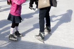 Outdoor Ice Skaters and Shadows Royalty Free Stock Images
