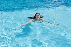 Free Outdoor Image Of Cheerful Adorable Young Lady Enjoying Active Pasttime, Fond Of Leisure Activities, Swimming In Swimming Pool Stock Images - 153217214