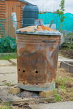 Outdoor incinerator for allotment or garden Royalty Free Stock Photo
