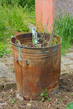 Outdoor incinerator full of garden rubbish Royalty Free Stock Image
