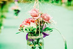 Indie Wedding Fresh Flower Outdoor Aisle Decoration. Outdoor Indie Wedding Fresh Flower Green Aisle Decoration royalty free stock photos
