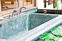 Outdoor jacuzzi bathtub in garden 1. Outdoor jacuzzi bathtub in garden of a luxury hotel in Thailand Stock Images