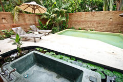 Outdoor jacuzzi bathtub in garden 3. Outdoor jacuzzi bathtub in garden of a luxury hotel in Thailand Royalty Free Stock Photos