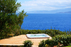 The outdoor jacuzzi at luxury hotel with a sea view Royalty Free Stock Image