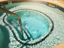 Outdoor Jacuzzi Pool with Fresh Blue Water for Massage and Spa.  Royalty Free Stock Images