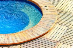 Outdoor jacuzzi pool with fresh blue water. stock photography