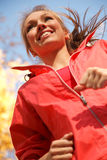 Outdoor jogging. Jogging woman in autumn forest .Low angle view royalty free stock photography