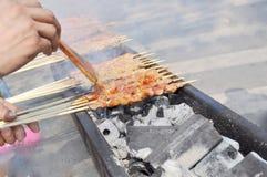 Outdoor kebab. Preparing shish kebab barbecue with grill Royalty Free Stock Images