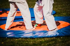 Outdoor kids karate judo in action. White clothing royalty free stock photo