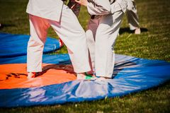 Outdoor kids karate judo in action. White clothing stock images