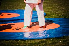 Outdoor kids karate judo in action. White clothing stock image