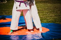 Outdoor kids karate judo in action. White clothing royalty free stock photography
