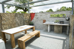 Outdoor kitchen. With barbecue grill , sink, and table Royalty Free Stock Photo