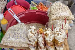 Outdoor kitchen in Ecuador, national appetizers of corn, grilled, boiled and popcorn. stock photo
