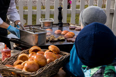 Outdoor kitchen hamburger sizzling on a frying table Stock Photos