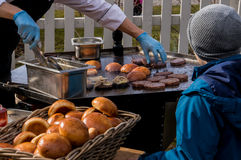 Outdoor kitchen hamburger sizzling on a frying table Royalty Free Stock Image