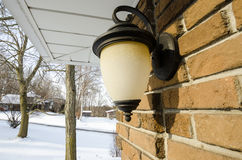 Outdoor Lamp. An outdoor lamp on a brick wall Royalty Free Stock Image