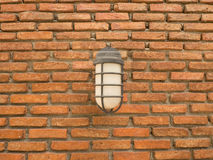 Outdoor lamp on a brick wall background Royalty Free Stock Photo