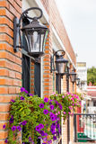 Outdoor lamp. Building decorated with outdoor lamp and flowers Stock Photo