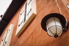 Outdoor lamp. On clay wall on italian house style Stock Image