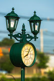 Outdoor lamp with the clock Stock Image