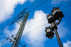 Outdoor lamp and electricity post. Royalty Free Stock Photos