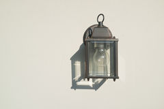 Outdoor lamp on the white wall Stock Photos