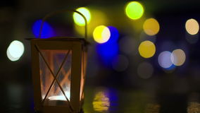Outdoor lantern with candle inside stirring with stock footage