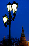 Outdoor lantern and Kremlin tower in winter snowing evening Royalty Free Stock Photo
