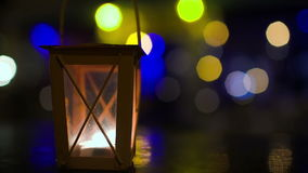 Outdoor lantern with lit candle stock video