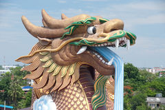 Outdoor large golden dragon in temple,Middle of Thailand. Stock Photo