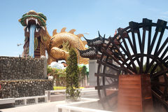Outdoor large golden dragon in temple,Middle of Thailand. Royalty Free Stock Images