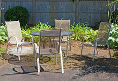Outdoor lawn furniture in garden setting Royalty Free Stock Photography